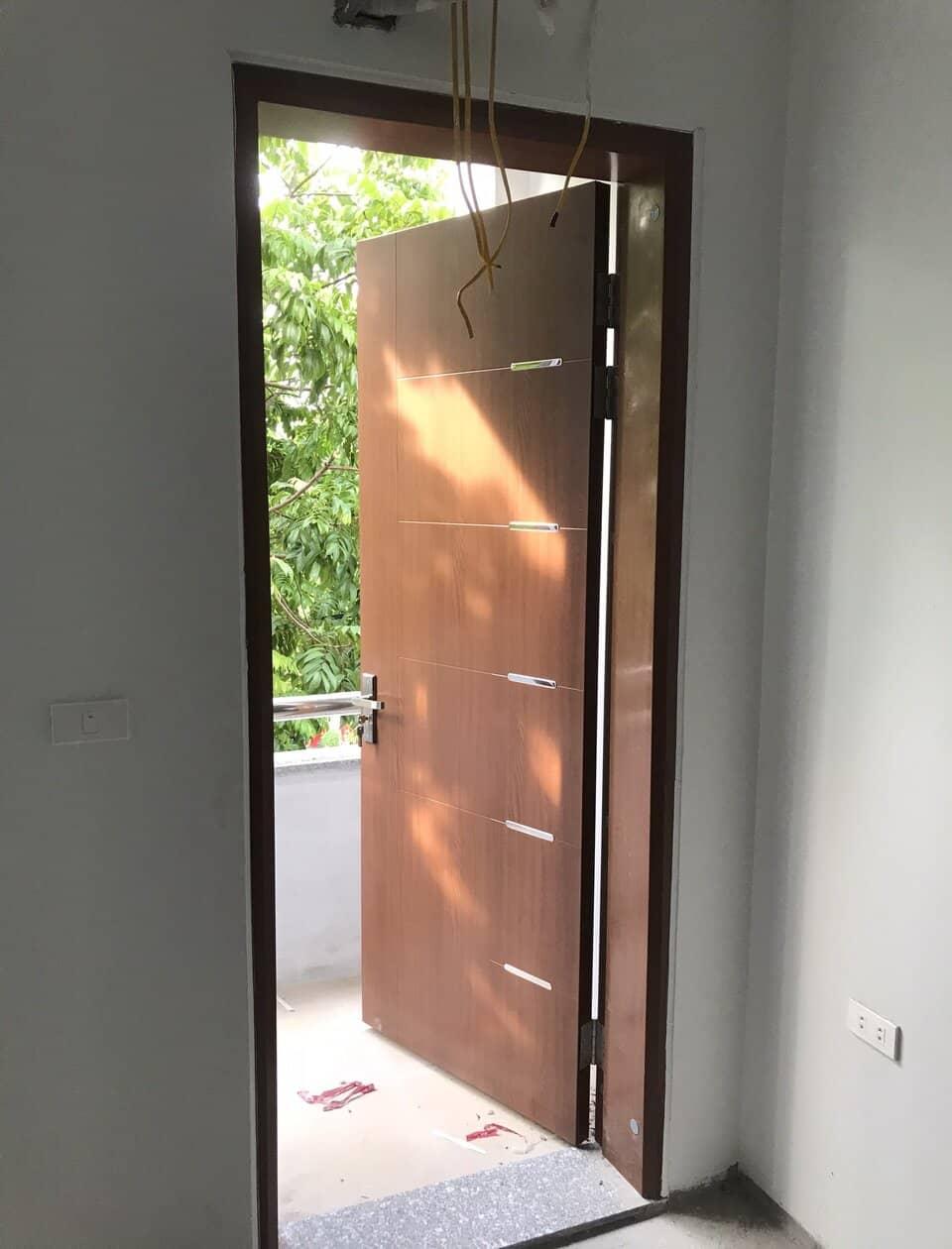 Cửa thép vân gỗ Galaxy 1 cánh hiện đại